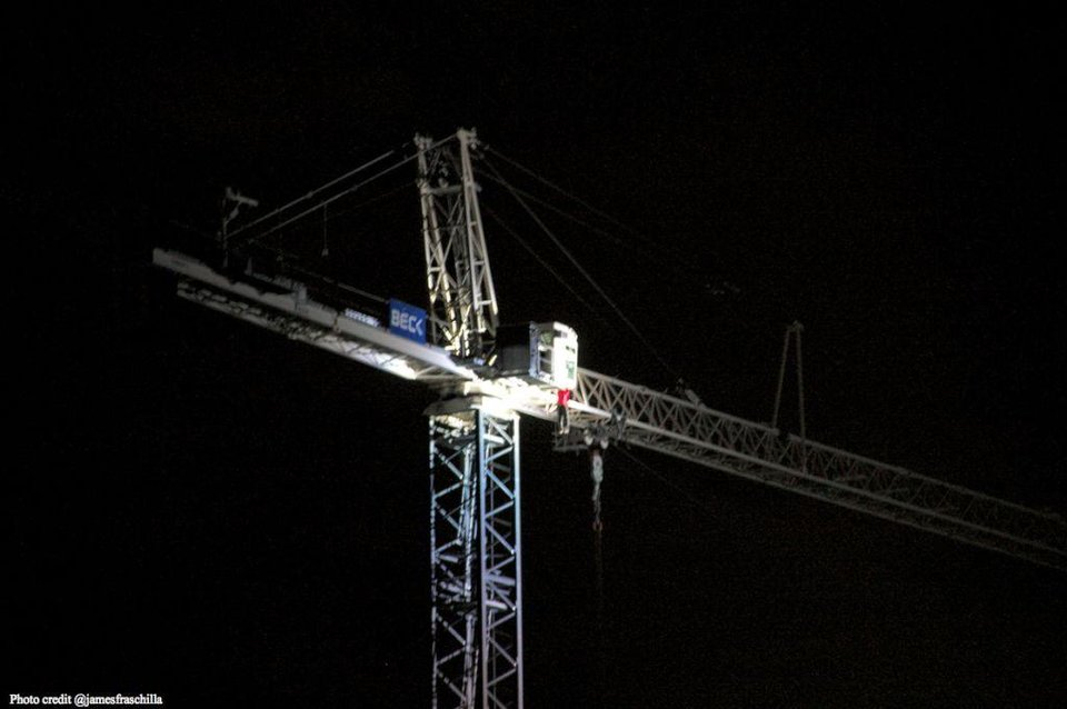 Lee Dell Thomas Jr. hangs on the edge of a crane near the campus of Southern Methodist University early Tuesday morning before falling to his death. Oklahoma basketball player James Fraschilla witnessed the event and took this photo. Photo provided by James Fraschilla.