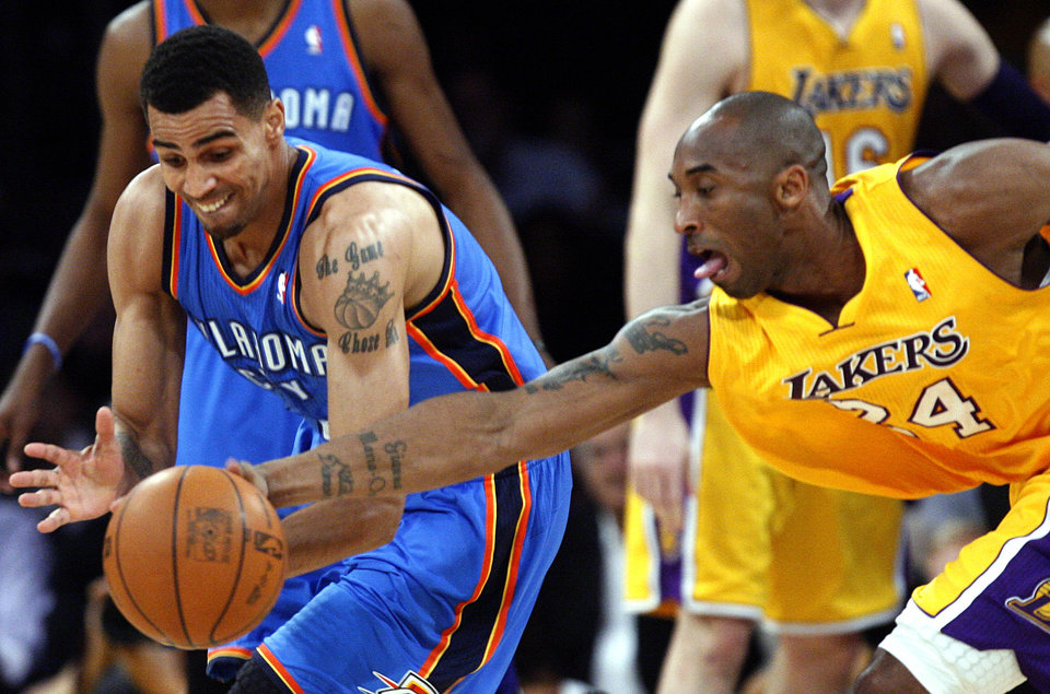 Los Angeles' Kobe Bryant (24) defends against Oklahoma City's Thabo Sefolosha (2) during Game 3 in the second round of the NBA basketball playoffs between the L.A. Lakers and the Oklahoma City Thunder at the Staples Center in Los Angeles, Friday, May 18, 2012. Photo by Nate Billings, The Oklahoman