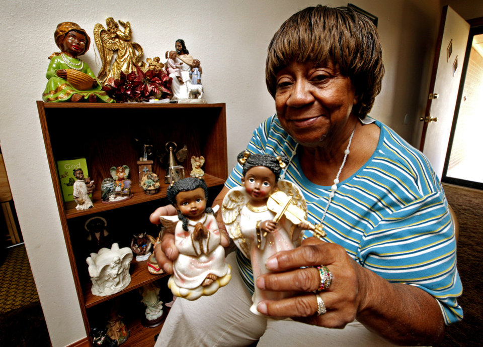 Photo - Willie Jean Yarbrough's collection of about 300 angels was shattered by the May 31 tornado and then another storm. But she says the loss has only strengthened her faith.  PHOTO BY STEVE SISNEY, THE OKLAHOMAN   STEVE SISNEY