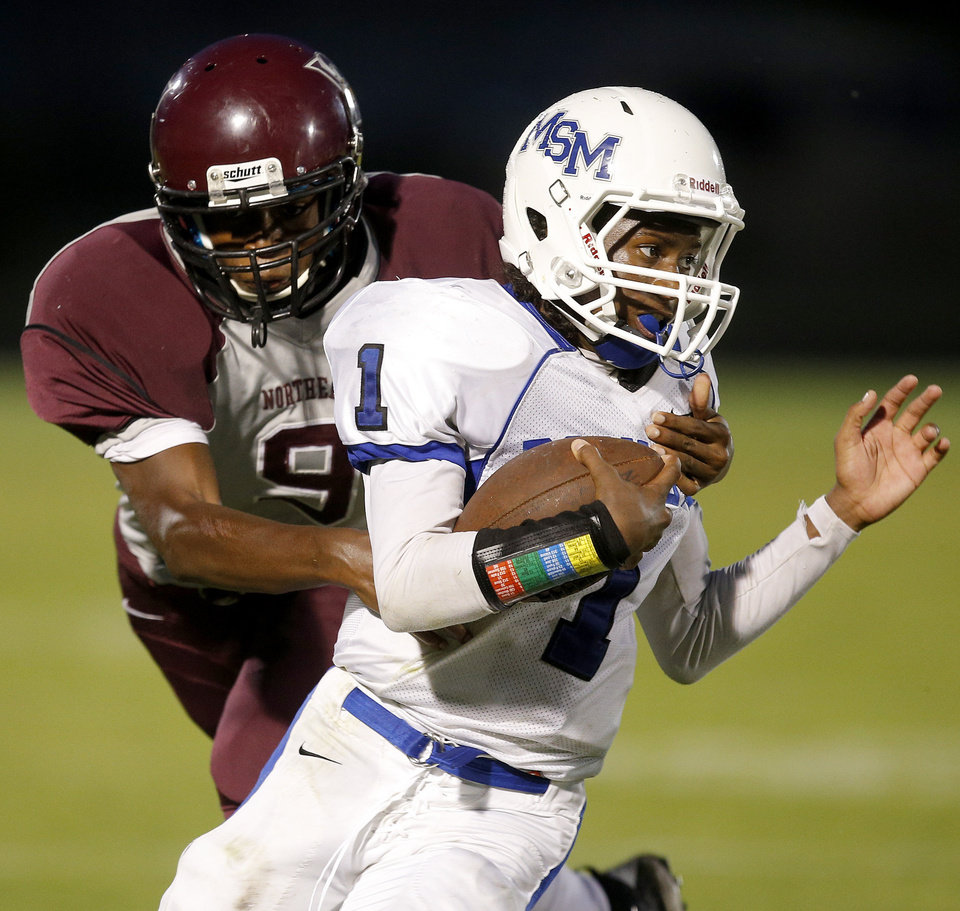 Mount St. Mary's Donavin Martin is brought down by Northeast's Trevon Wiles during their high school football game at Douglass in Oklahoma City, Thursday, Sept. 19, 2013. Photo by Bryan Terry, The Oklahoman