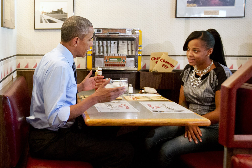 Photo - President Barack Obama meets with Tanei Benjamin  at the Charcoal Pit in Wilmington, Del., Thursday, July 17, 2014, before speaking about transportation and infrastructure. Benjamin wrote the president a letter about her struggles as a single mother. (AP Photo/Jacquelyn Martin)