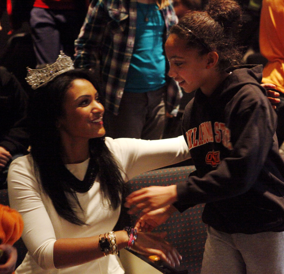 Photo -  Nine-year-old Addison Roberts from Westwood elementary school (right) hugs Nina Davuluri, 2014 Miss America, after Davuluri gave a speech to Stillwater third-grade students Thursday at the Wes Watkins Center. Davuluri lived part of her childhood in Ada before eventually moving to New York. Photo by KT King, for The Oklahoman   KT King -  KT King, The Oklahoman