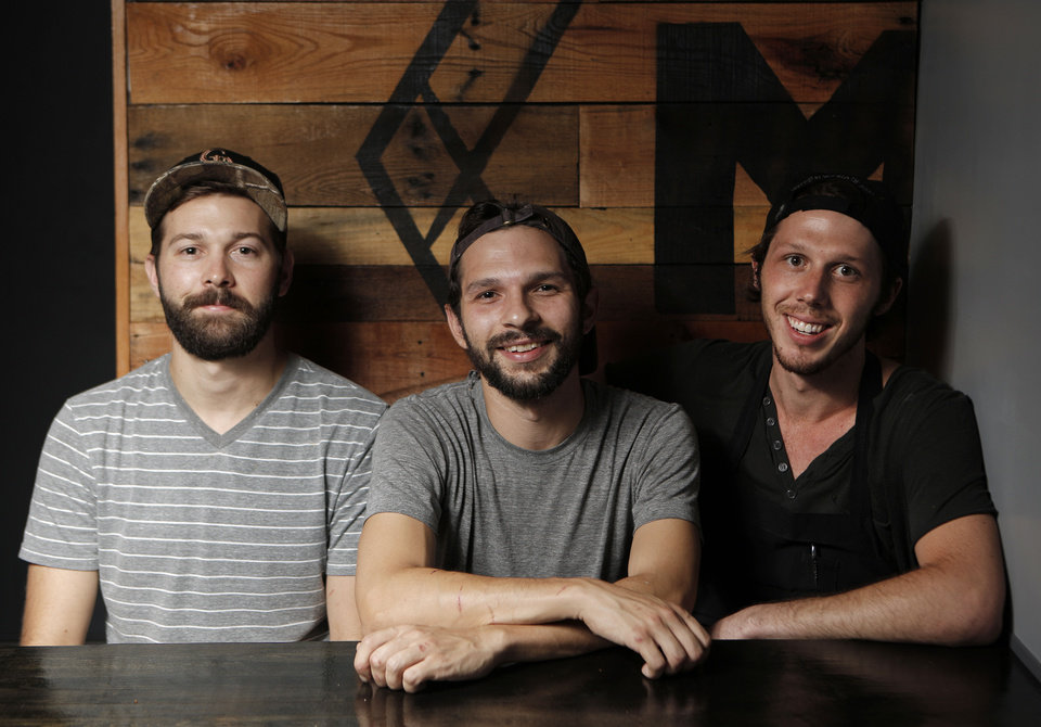 Photo - Cody Rowan, John Harris, and Joey Morris, recemtly opened The Mule in the Plaza District of Oklahoma City.  Garett Fisbeck - THE OKLAHOMAN