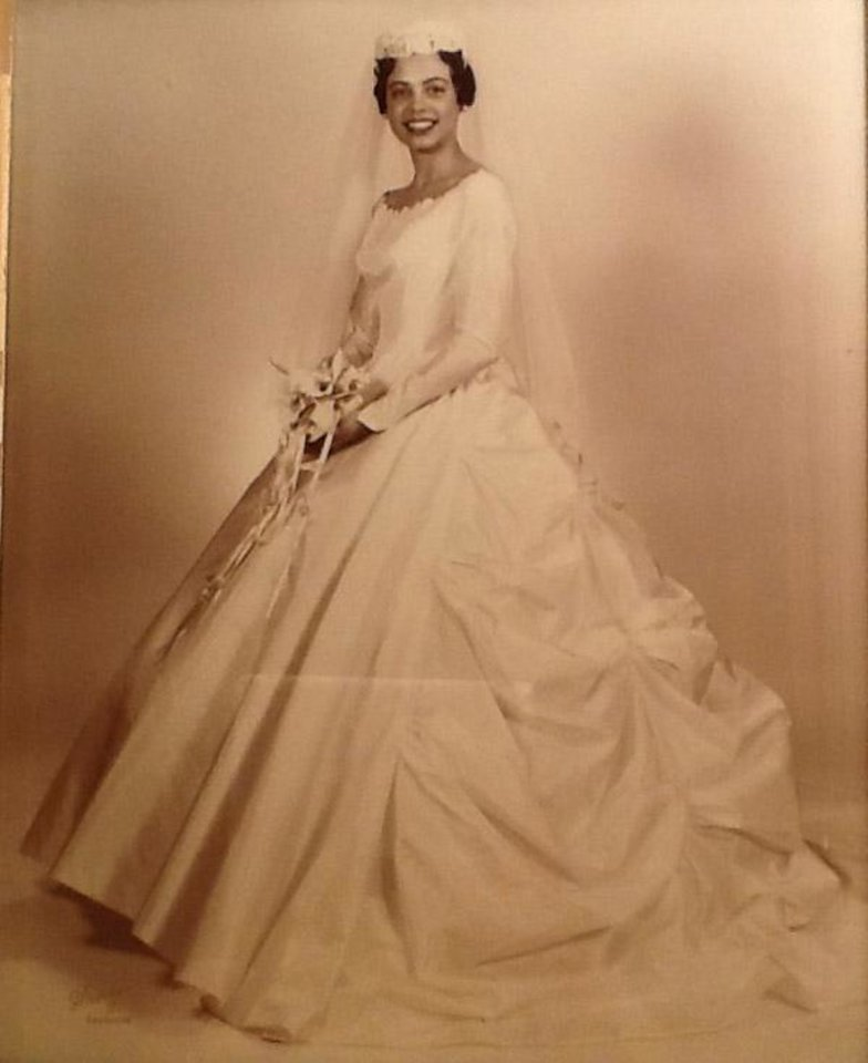Photo - People always say you know when you have found the right wedding dress, no matter how many you have tried on. It did not matter that the right gown was the first one Patricia Garnos happened to try on. Her pillbox veil, a stylish trend in the 1960s, accompanied her cascading ruche skirt on Dec. 11, 1960. To add more volume, a hoop petticoat was added.