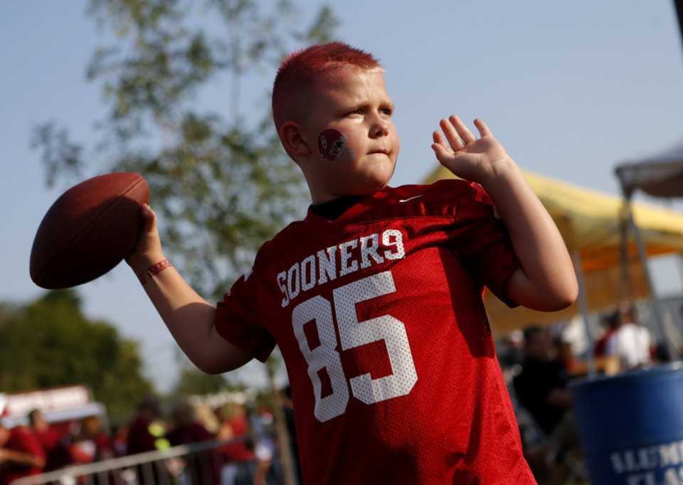 Photo - Brodie Andrews, 9, of Ada, Okla.,throws a football before a college football game between the University of Oklahoma Sooners (OU) and the Kansas State University Wildcats (KSU) at Gaylord Family-Oklahoma Memorial Stadium, Saturday, September 22, 2012. Photo by Bryan Terry, The Oklahoman