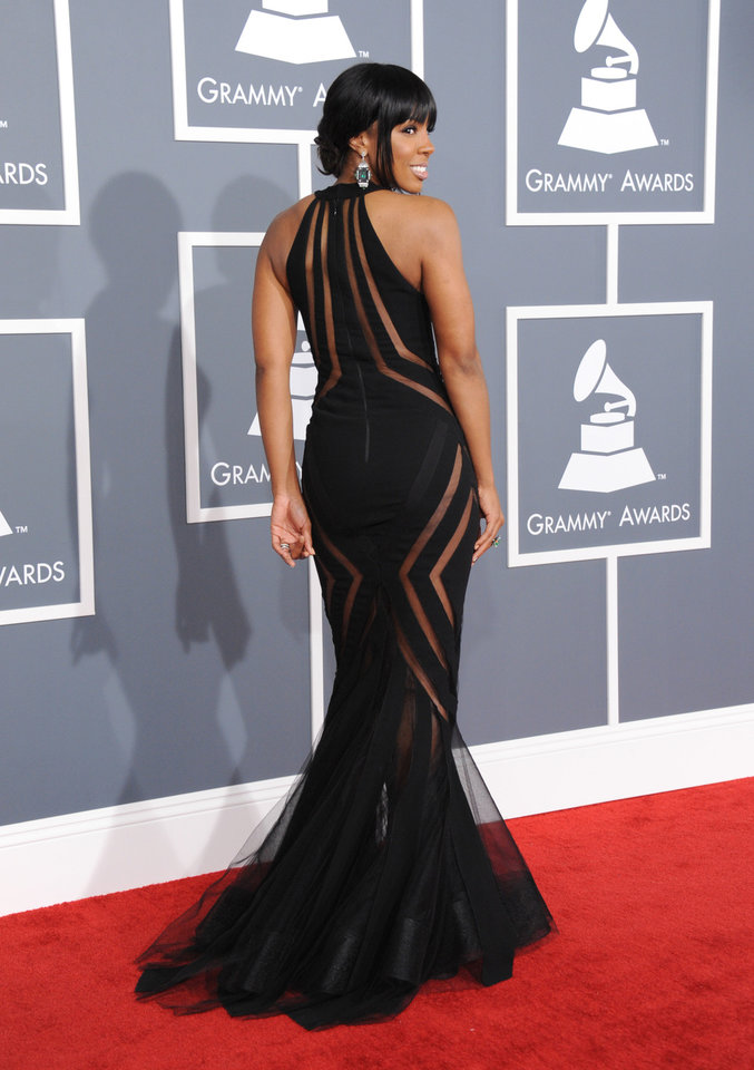 Photo - Kelly Rowland arrives at the 55th annual Grammy Awards wearing a dress from the Georges Chakra Couture Collection on Sunday, Feb. 10, 2013, in Los Angeles. (Photo by Jordan Strauss/Invision/AP)