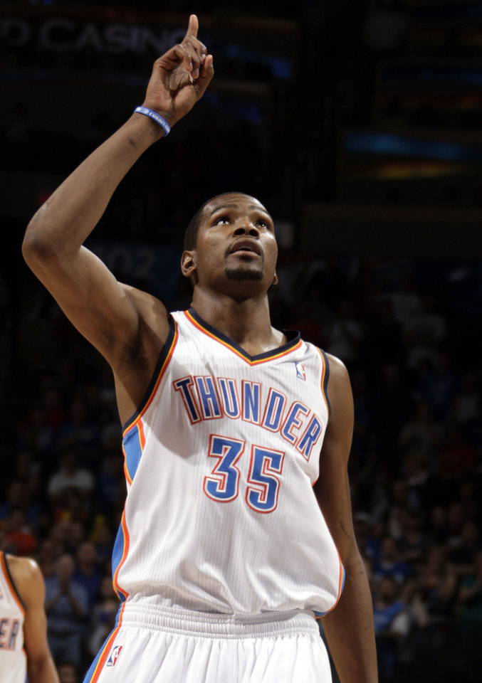 Oklahoma City\'s Kevin Durant (35) points to the ceiling after making a foul shot during the NBA basketball game between the Oklahoma City Thunder and the Houston Rockets at the Chesapeake Energy Arena, Tuesday, March 13, 2012. Photo by Sarah Phipps, The Oklahoman.