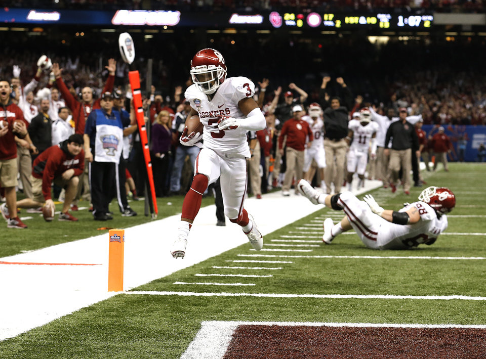 Photo - Oklahoma's Sterling Shepard (3) scores a touchdown during the NCAA football BCS Sugar Bowl game between the University of Oklahoma Sooners (OU) and the University of Alabama Crimson Tide (UA) at the Superdome in New Orleans, La., Thursday, Jan. 2, 2014.  .Photo by Sarah Phipps, The Oklahoman