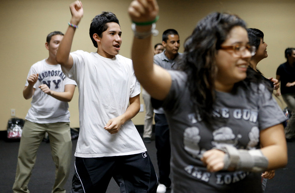 Photo - Justin Reyes, 15, participates in a Zumba class at ASTEC Charter School. Photo by Bryan Terry, The Oklahoman