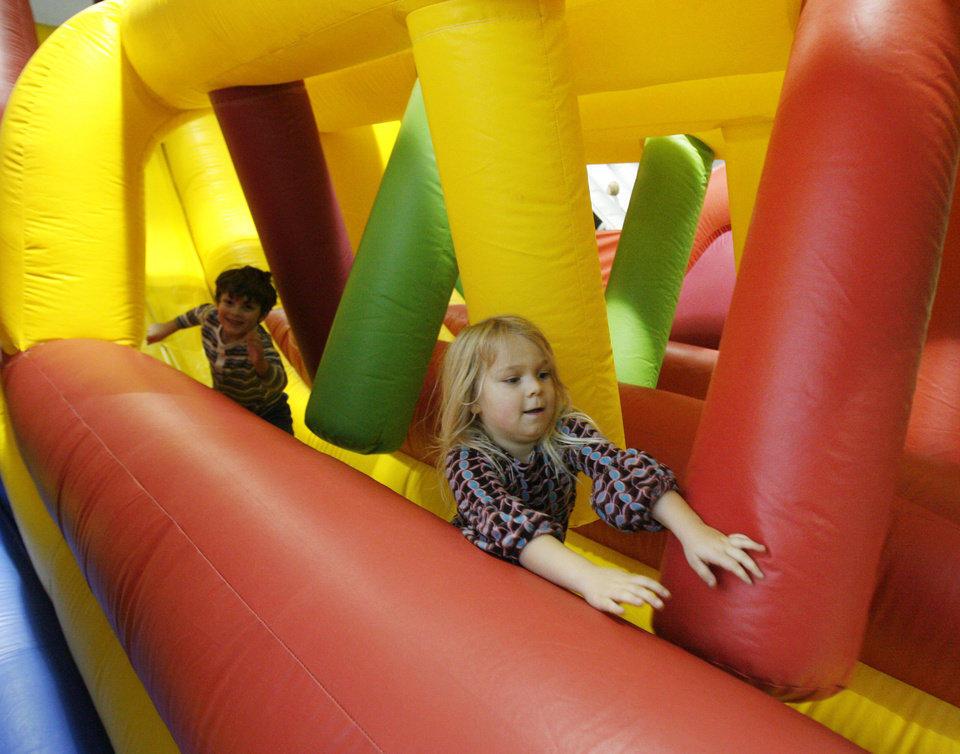 Five-year-old Makayla Robles plays in one of the inflatables at Bouncin\' Craze in north Oklahoma City, OK, Friday, Jan. 2, 2009. BY PAUL HELLSTERN, THE OKLAHOMAN