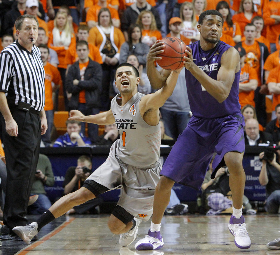 Photo - Oklahoma State's Cezar Guerrero (1) goes for the ball beside Kansas State's Shane Southwell (1) during an NCAA college basketball game between the Oklahoma State University Cowboys (OSU) and the Kansas State University Wildcats (KSU) at Gallagher-Iba Arena in Stillwater, Okla., Saturday, Jan. 21, 2012. Photo by Bryan Terry, The Oklahoman