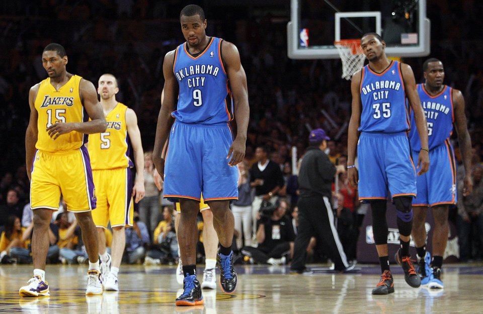Photo - Oklahoma City's Serge Ibaka (9), Kevin Durant (35) and Kendrick Perins (5) walk along with Los Angeles' Metta World Peace (15) and Steve Blake (5) to the other end of the court after a foul by the Thunder with 12.9 seconds left in Game 3 in the second round of the NBA basketball playoffs between the L.A. Lakers and the Oklahoma City Thunder at the Staples Center in Los Angeles, Friday, May 18, 2012. Photo by Nate Billings, The Oklahoman