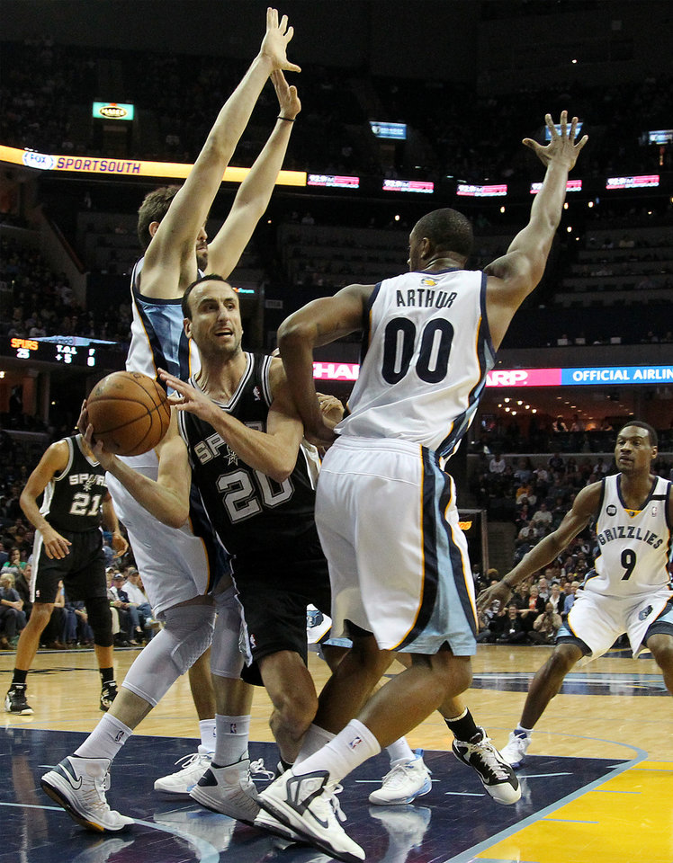 Photo - San Antonio Spurs guard Manu Ginobili (20), of Argentina, drives between Memphis Grizzlies center Marc Gasol, left, of Spain, forward Darrell Arthur (00) and guard Tony Allen (9) in the first half of an NBA basketball game on Friday, Jan. 11, 2013, in Memphis, Tenn. (AP Photo/Lance Murphey)