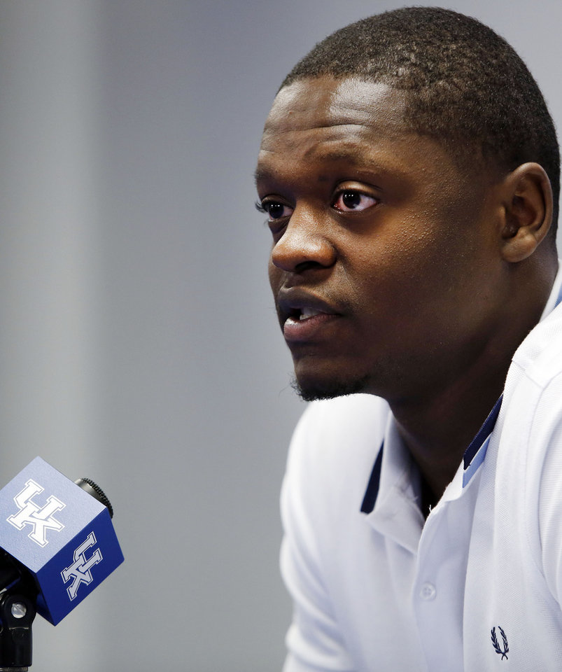 Photo - Kentucky's Julius Randle announces he will enter his name in the NBA draft during a news conference in Lexington, Ky., Tuesday, April 22, 2014. (AP Photo/James Crisp)