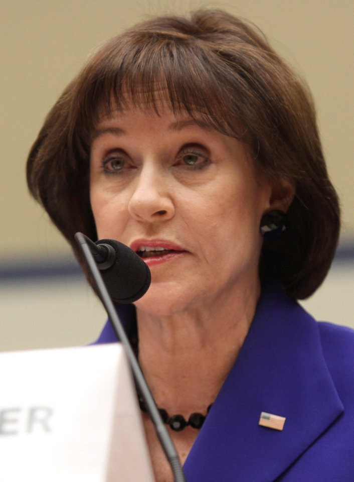Photo - Former Internal Revenue Service (IRS) official Lois Lerner speaks on Capitol Hill in Washington, Wednesday, March 5, 2014, during the House Oversight and Government Reform Committee hearing on the the agency's targeting of tea party groups, where she invoked her constitutional right not to incriminate herself.  (AP Photo/Lauren Victoria Burke)