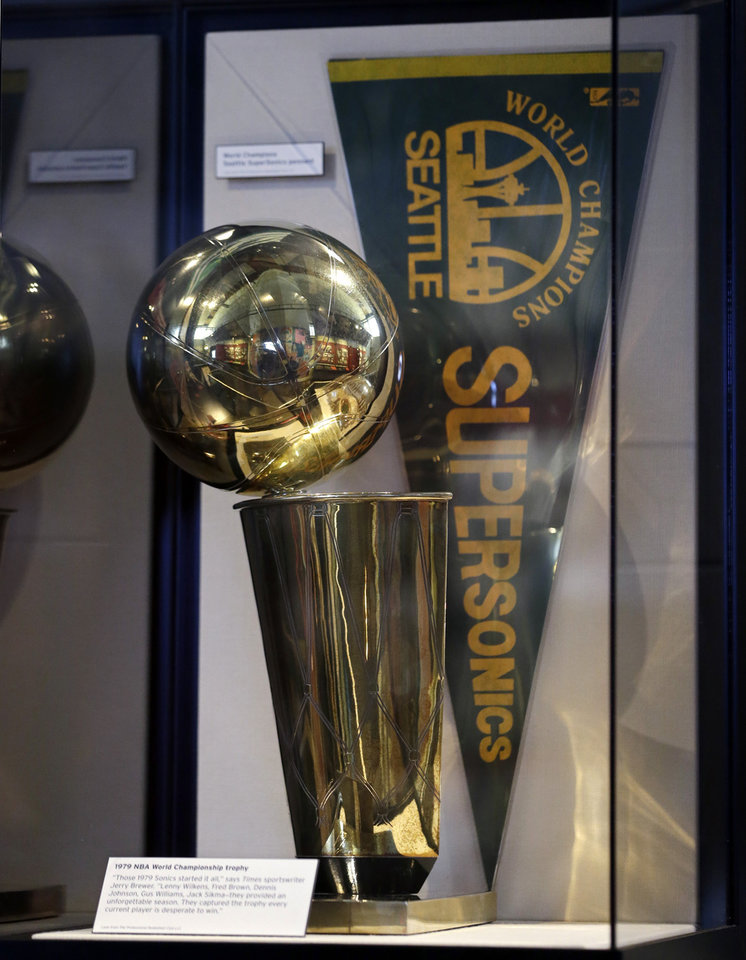 Photo - In this photo taken Wednesday, Dec. 26, 2012, the Seattle SuperSonics 1979 NBA championship trophy is on display at Seattle's Museum of History and Industry, in the city's South Lake Union neighborhood.