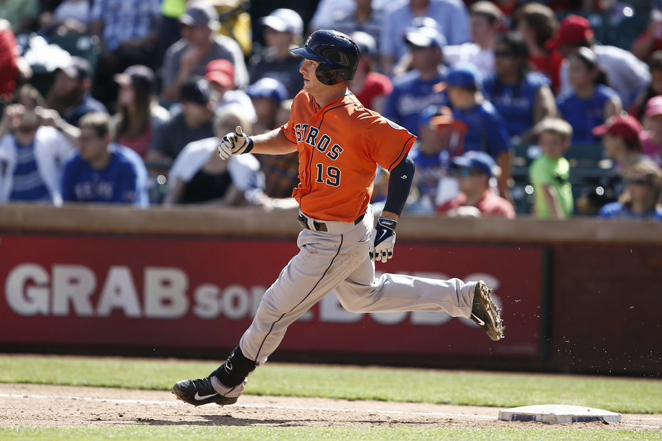 Photo - Houston Astros' Robbie Grossman rounds first base on a single against the Texas Rangers during the eighth inning of a baseball game, Sunday, April 13, 2014, in Arlington, Texas. The Rangers won 1-0. (AP Photo/Jim Cowsert)