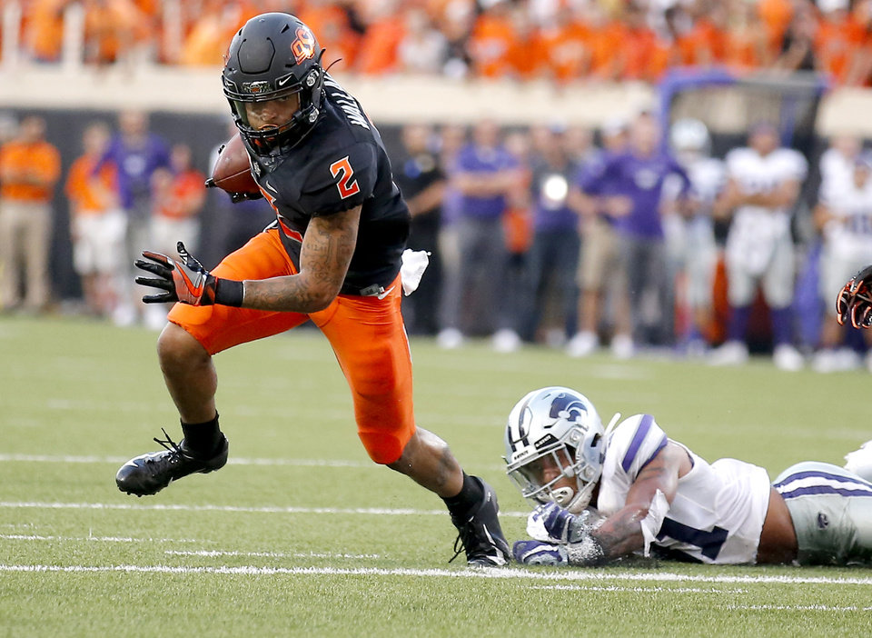 Photo - Oklahoma State's Tylan Wallace (2) gets by Kansas State's Jahron McPherson (31) in the second half during the college football game between the Oklahoma State Cowboys and the Kansas State Wildcats at Boone Pickens Stadium in Stillwater, Okla., Saturday, Sept. 28, 2019. [Sarah Phipps/The Oklahoman]