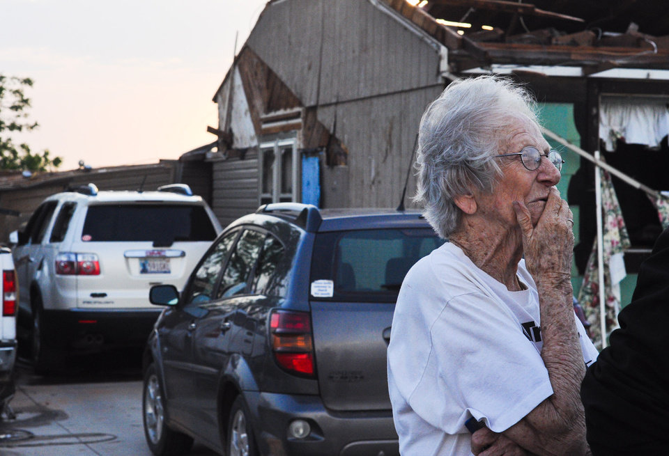 Ida Clark, 85 of Carney, stands outside of her house which was damaged by a tornado that went through Carney, Okla. on May 19, 2013. Clark's home of 50 years was destroyed by the tornado with Clark and her son inside the house.  KT King/For the Oklahoman