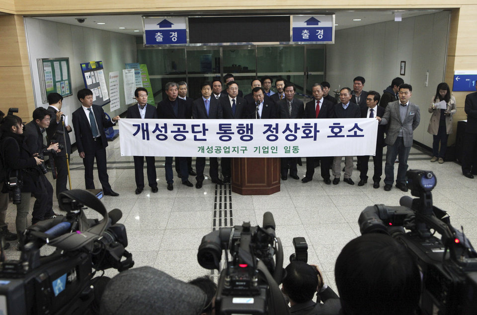South Korean small business owners who run factories in the sprawling complex in North Korea\'s border city of Kaesong, hold a press conference to demand that the North Korea to normalize the border crossings in front of the gateways to North Korea at the customs, immigration and quarantine office in Paju, South Korea, near the border village of Panmunjom, Thursday, April 4, 2013. North Korea on Wednesday barred South Korean workers from entering a jointly run factory park just over the heavily armed border in the North, officials in Seoul said, a day after Pyongyang announced it would restart its long-shuttered plutonium reactor and increase production of nuclear weapons material. The banner reads