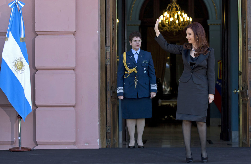 Photo - Argentina's President Cristina Fernandez waves to supporters outside the government house as she waits for  the arrival of Venezuela's President Nicolas Maduro in Buenos Aires, Argentina, Wednesday, May 8, 2013. Maduro is on a South American tour that began in Uruguay and will end in Brazil. (AP Photo/Natacha Pisarenko)