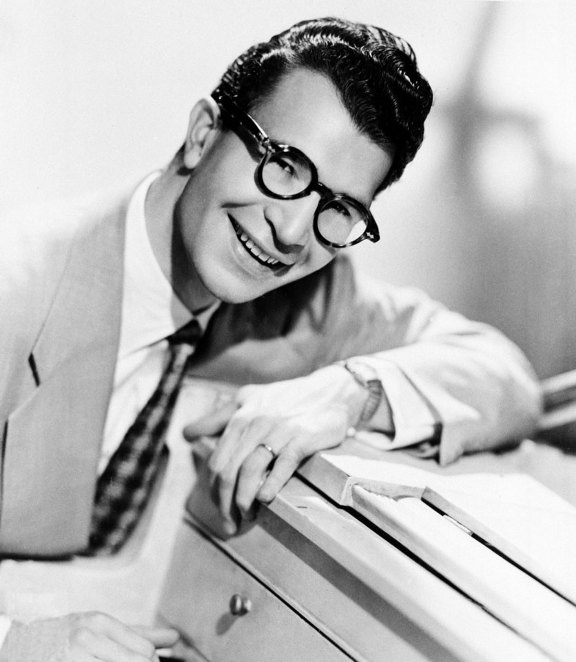 Photo - FILE - This 1956 file photo shows American composer, pianist and jazz musician Dave Brubeck. Brubeck, a pioneering jazz composer and pianist died Wednesday, Dec. 5, 2012 of heart failure, after being stricken while on his way to a cardiology appointment with his son. He would have turned 92 on Thursday.  (AP Photo, file)