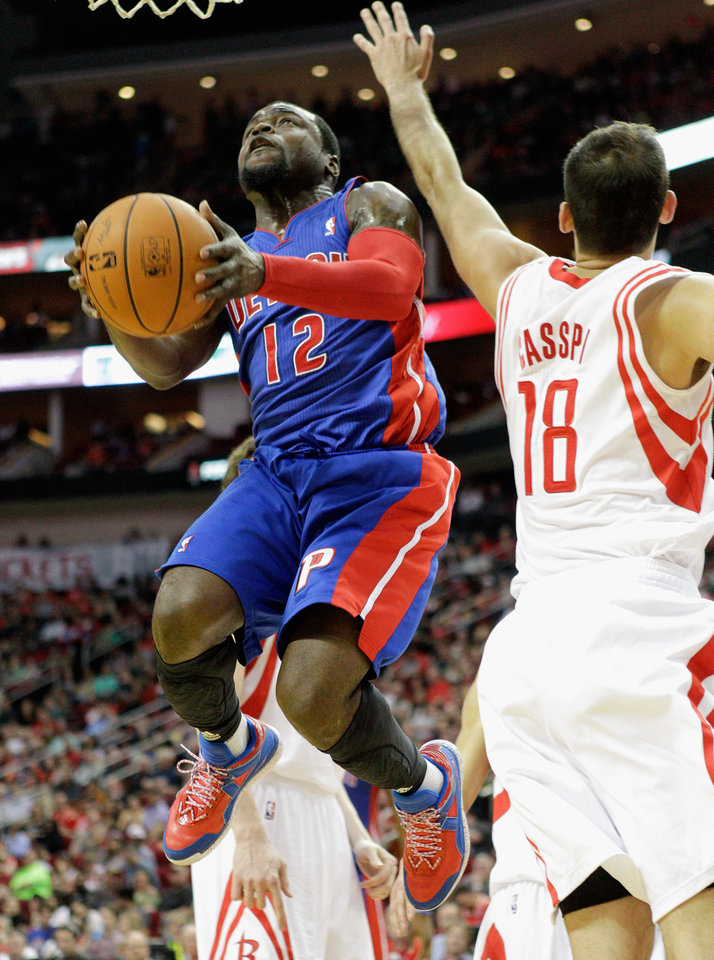 Photo - Detroit Pistons guard Will Bynum (12) drives past Houston Rockets'  Omri Casspi (18) for a layup during the first half of an NBA basketball game, Saturday, March 1, 2014, in Houston. (AP Photo/Bob Levey)