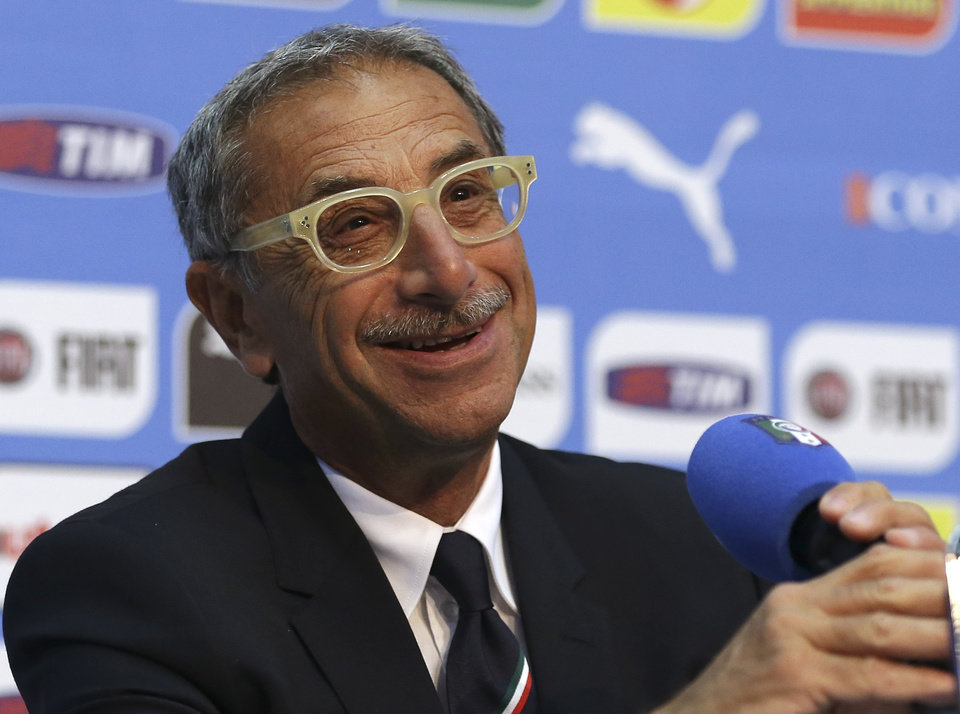 Italy team physician Enrico Castellacci smiles as he listens to a question during a press conference at the Casa Azzurri in Mangaratiba, Brazil, Sunday, June 15, 2014. Italy plays in group D of the 2014 soccer World Cup. (AP Photo/Antonio Calanni)