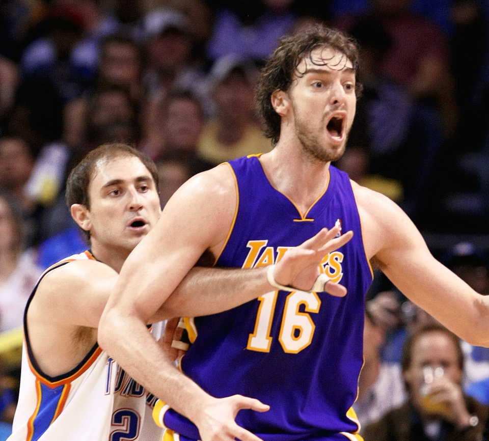 "The Thunder's Nenad Krstic, left, had a big game during the Thunder's March 26 win over L.A., while Pau Gasol, right, got called ""soft"" by his coach.  PHOTO BY HUGH SCOTT, THE OKLAHOMAN"