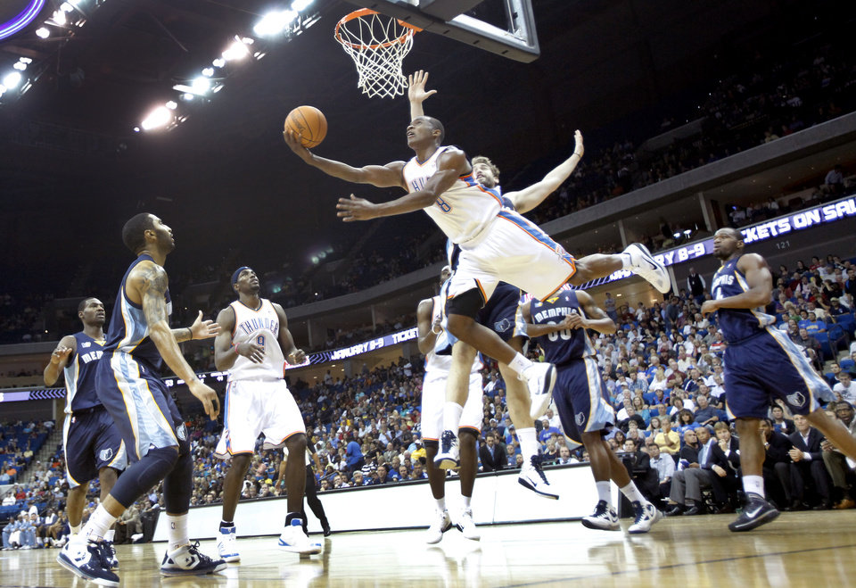 Photo - OKC's Elijah Millsap (8) drives to the basket during the first half of the preseason NBA basketball game between the Oklahoma City Thunder and the Memphis Grizzlies on Tuesday, Oct. 12, 2010, in Tulsa, Okla.  Photo by Chris Landsberger, The Oklahoman