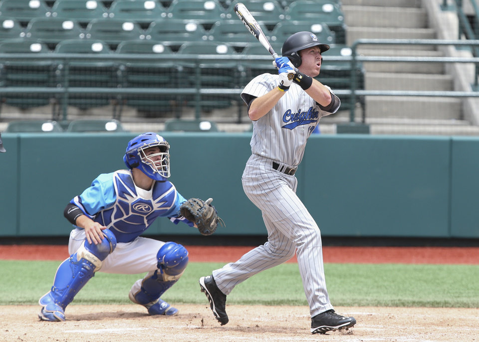 Photo - Creighton outfielder Mike Gerber hits a single to score a run in the third inning of their NCAA college baseball game against Seton Hall in the Big East Conference tournament, Saturday, May 24, 2014, in New York. Creighton won 2-1. (AP Photo/John Minchillo)