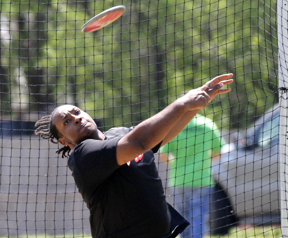 Del City's Deshawn Craft throws the discus during the 5A and 6A State Track Meet in Yukon, OK, Saturday, May 11, 2013,  By Paul Hellstern, The Oklahoman