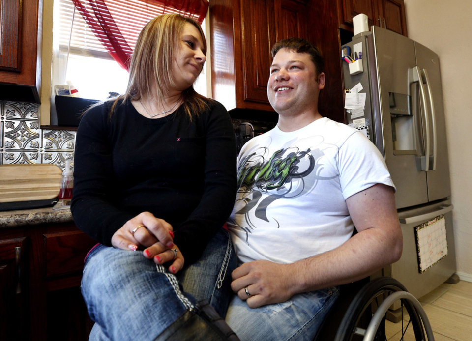 Photo - Jean Pittman and her husband, EH, show off their remodeled and handicap-accessible kitchen. He was injured in the May 20 Moore tornado. PHOTO BY STEVE SISSNEY, THE OKLAHOMAN.  STEVE SISNEY - THE OKLAHOMAN