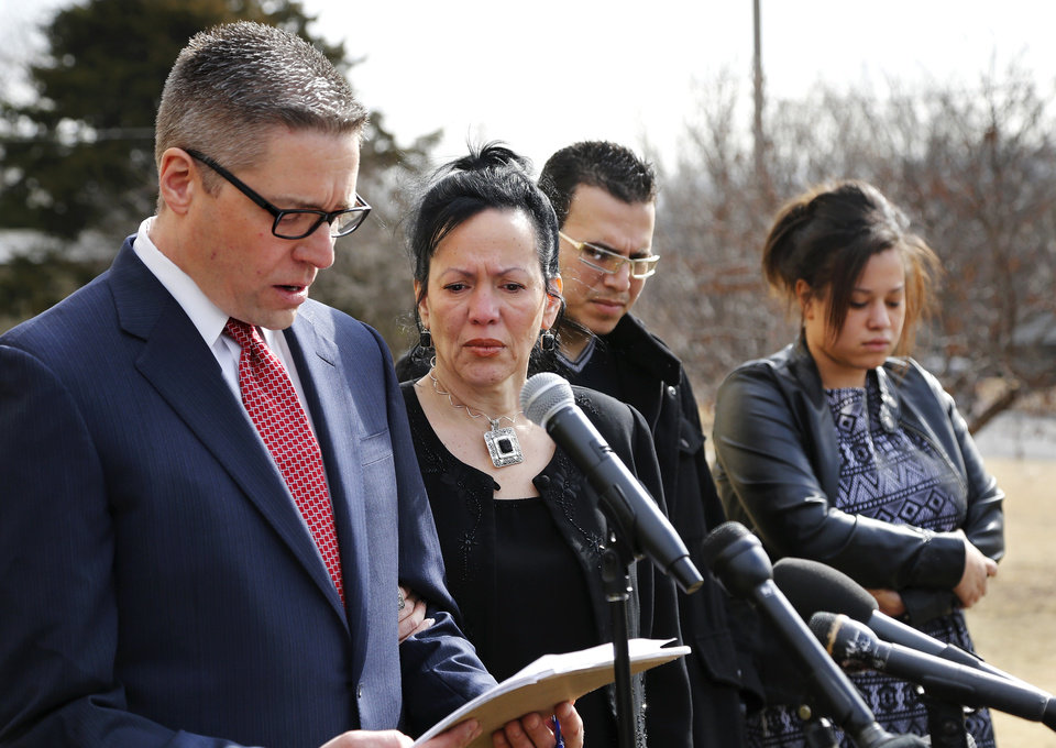 Photo -  Attorney Michael Brooks-Jimenez, left, speaks during a news conference on Tuesday regarding the death of Luis Rodriguez, who died Feb. 15 after being handcuffed by police in the Warren Theatre parking lot. To his right is Rodriguez's wife, Nair, his daughter, Luinahi, and another family member. Photo by Jim Beckel, The Oklahoman   Jim Beckel -