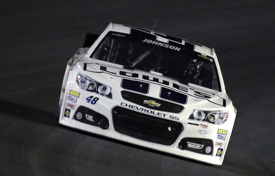 Photo - Jimmie Johnson drives through Turn 4 during the NASCAR Sprint Cup Series auto race at Charlotte Motor Speedway in Concord, N.C., Saturday, Oct. 12, 2013. (AP Photo/Gerry Broome)