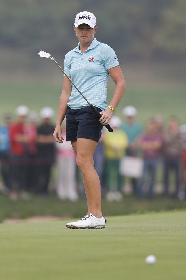 Photo - Stacy Lewis of the United States follows her putt on the third green during the final round of the Reignwood LPGA Classic golf tournament at Pine Valley Golf Club on the outskirts of Beijing, China, Sunday, Oct. 6, 2013. (AP Photo/Alexander F. Yuan)