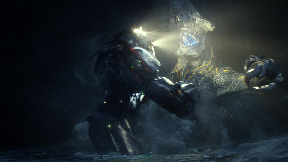 "Photo -  This film publicity image released by Warner Bros. Pictures shows the Gipsy Danger robot battling the Knifehead monster in a scene from ""Pacific Rim."" ""Pacific Rim"" fulfills a very basic boyhood fantasy: big ol' robots and giant monsters slugging it out. The concept to Guillermo del Toro's ""Godzilla""-sized film is about as simple as it gets, but actually constructing such mammoth creations is a far more arduous undertaking.  (AP Photo/Warner Bros. Pictures) ORG XMIT: NYET525"