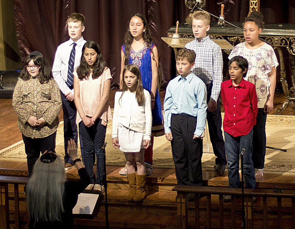 Photo - Members of the new interfaith multicultural choir Youth in Unison perform a song at the interfaith Day of Reflection event on Thursday, May 4, at St. Luke's United Methodist Church in Oklahoma City. [Photo by Benjamin J. Mowbray]