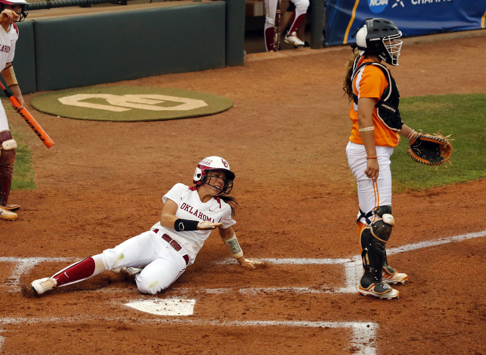 Photo - Oklahoma's Destinee Martinez scores as the University of Oklahoma Sooner (OU) softball team plays Tennessee in the first game of the NCAA super regional at Marita Hynes Field on May 23, 2014 in Norman, Okla. Photo by Steve Sisney, The Oklahoman