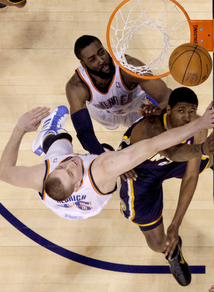 Oklahoma City's Cole Aldrich (45) and James Harden (13) defend Indiana's Paul George (24)  during the NBA basketball game between the Oklahoma City Thunder and the Indiana Pacers at the Oklahoma City Arena, Wednesday, March 2, 2011. Photo by Bryan Terry, The Oklahoman