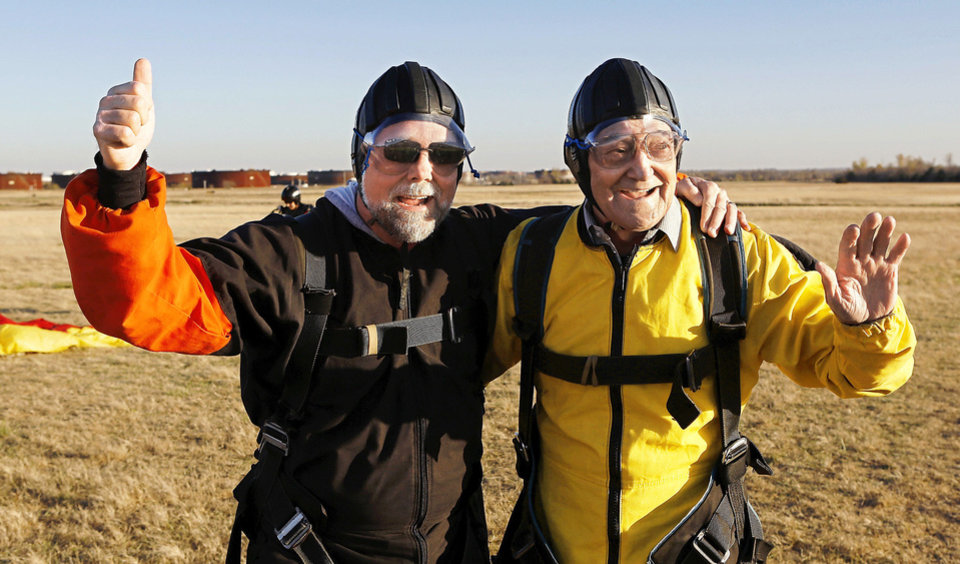 Warren Crawford, right, and his son Steve Crawford, celebrate after sky diving Saturday at Oklahoma Skydiving Center in Cushing. Photo by Jim Beckel, The Oklahoman