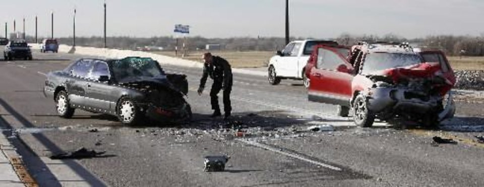 Photo - Oklahoma City police investigate a fatality accident on south Western Ave just south of I-40 in Oklahoma City Monday, Feb. 11, 2013. The fatality was in the red vehicle at right. Photo by Paul B. Southerland,