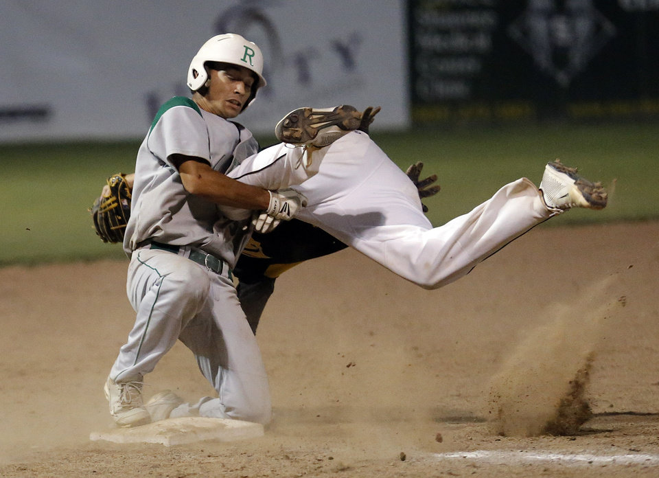Rattan's Cade Clay and Roff's Dalton Reed collide at third base during the Class A high school state baseball championships at Shawnee, Okla., Saturday, June 8, 2013. Photo by Sarah Phipps, The Oklahoman