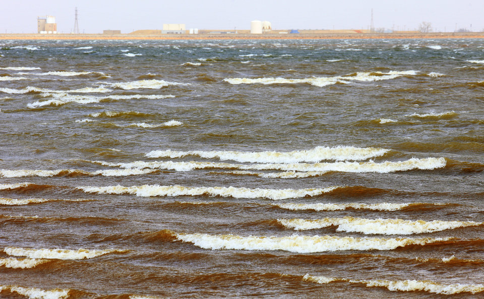 Photo -      Water rolls in waves Thursday as high winds push across Lake Hefner in Oklahoma City. Photo by Paul B. Southerland, The Oklahoman   PAUL B. SOUTHERLAND -