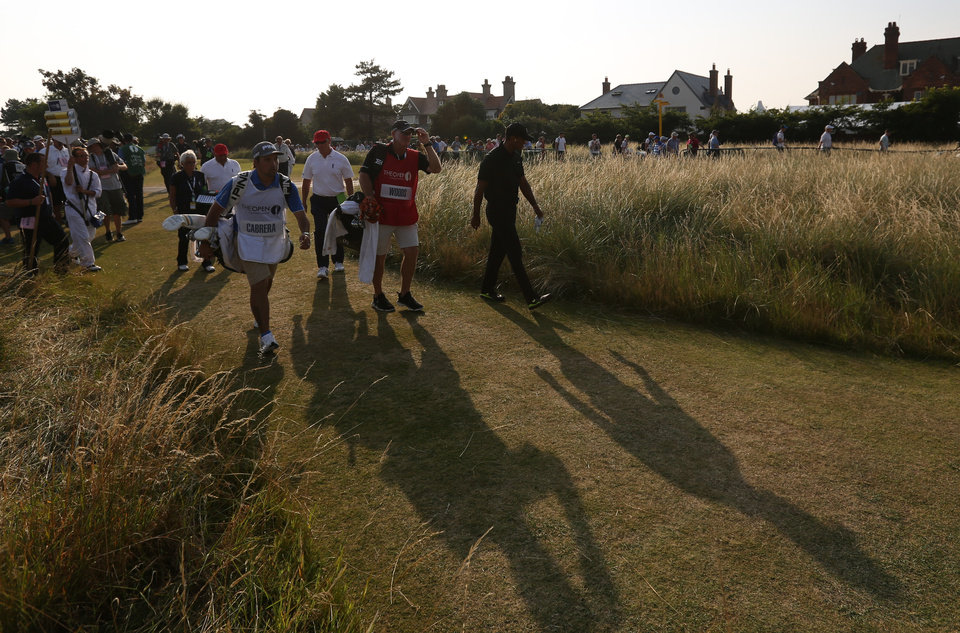Photo - Tiger Woods of the US walks off the 18th hole after finishing his round on the second day of the British Open Golf championship at the Royal Liverpool golf club, Hoylake, England, Friday July 18, 2014. (AP Photo/Jon Super)