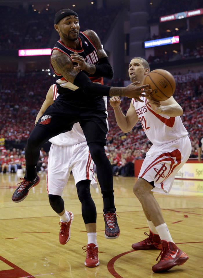 Photo - Portland Trail Blazers' Mo Williams (25) passes the ball around Houston Rockets' Francisco Garcia (32) during the second quarter in Game 1 of an opening-round NBA basketball playoff series Sunday, April 20, 2014, in Houston. (AP Photo/David J. Phillip)