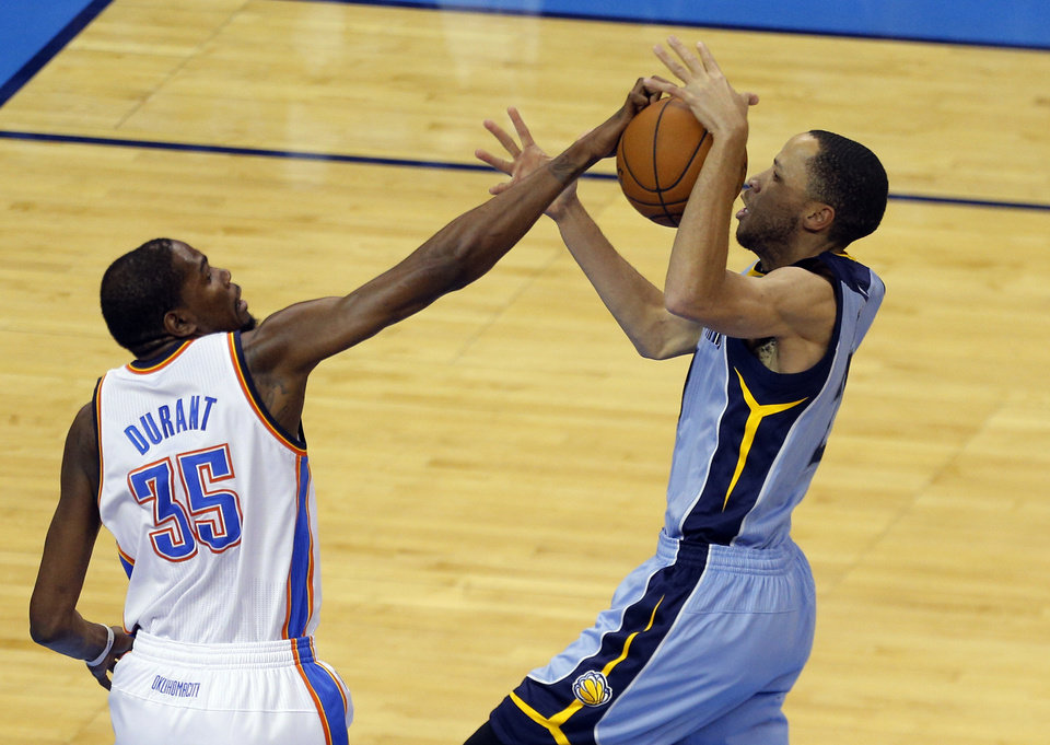 Photo - Oklahoma City's Kevin Durant (35) defends against Memphis' Tayshaun Prince (21) during Game 2 in the first round of the NBA playoffs between the Oklahoma City Thunder and the Memphis Grizzlies at Chesapeake Energy Arena in Oklahoma City, Monday, April 21, 2014. Photo by Sarah Phipps, The Oklahoman