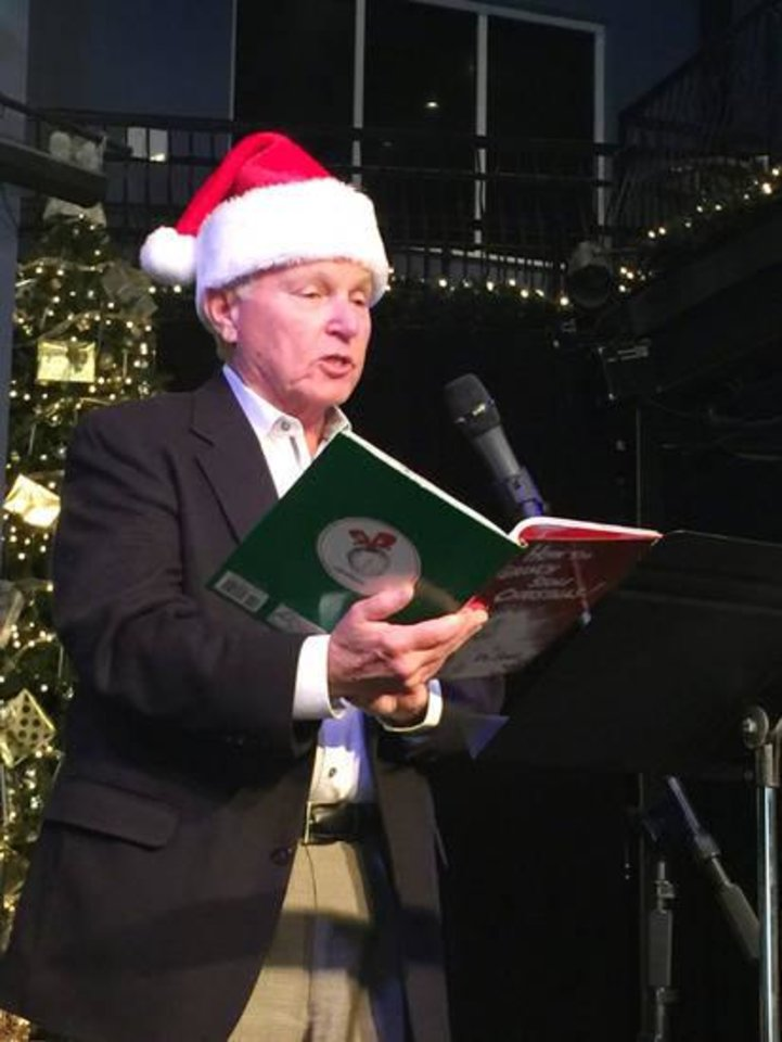 "Photo - Police Chief Bob Ricks reads ""How the Grinch Stole Christmas""."