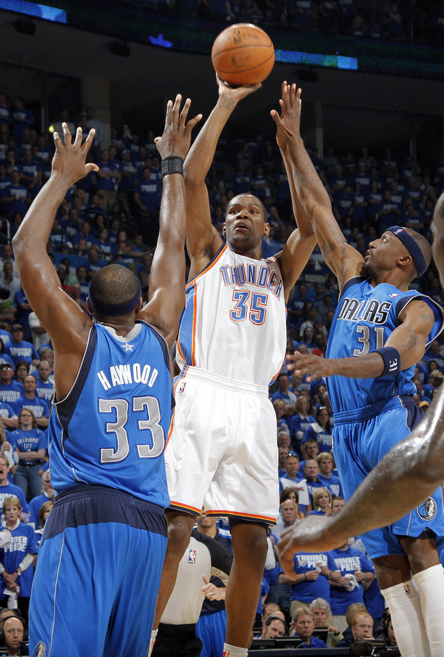 Oklahoma City's Kevin Durant (35) shoots the ball over Brendan Haywood (33) of Dallas and Jason Terry (31) of Dallas during game 3 of the Western Conference Finals of the NBA basketball playoffs between the Dallas Mavericks and the Oklahoma City Thunder at the OKC Arena in downtown Oklahoma City, Saturday, May 21, 2011. Photo by Chris Landsberger, The Oklahoman
