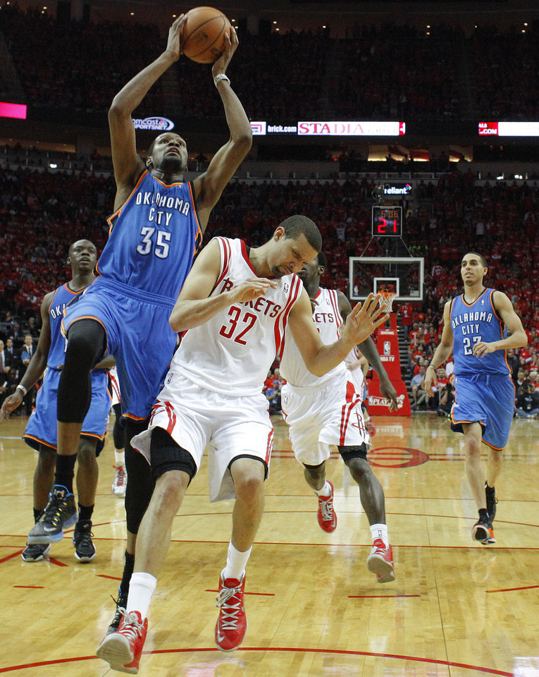 Photo - Oklahoma City's Kevin Durant (35) goes to the basket beside Houston's Francisco Garcia (32) during Game 6 in the first round of the NBA playoffs between the Oklahoma City Thunder and the Houston Rockets at the Toyota Center in Houston, Texas, Friday, May 3, 2013. Oklahoma City won 103-94. Photo by Bryan Terry, The Oklahoman